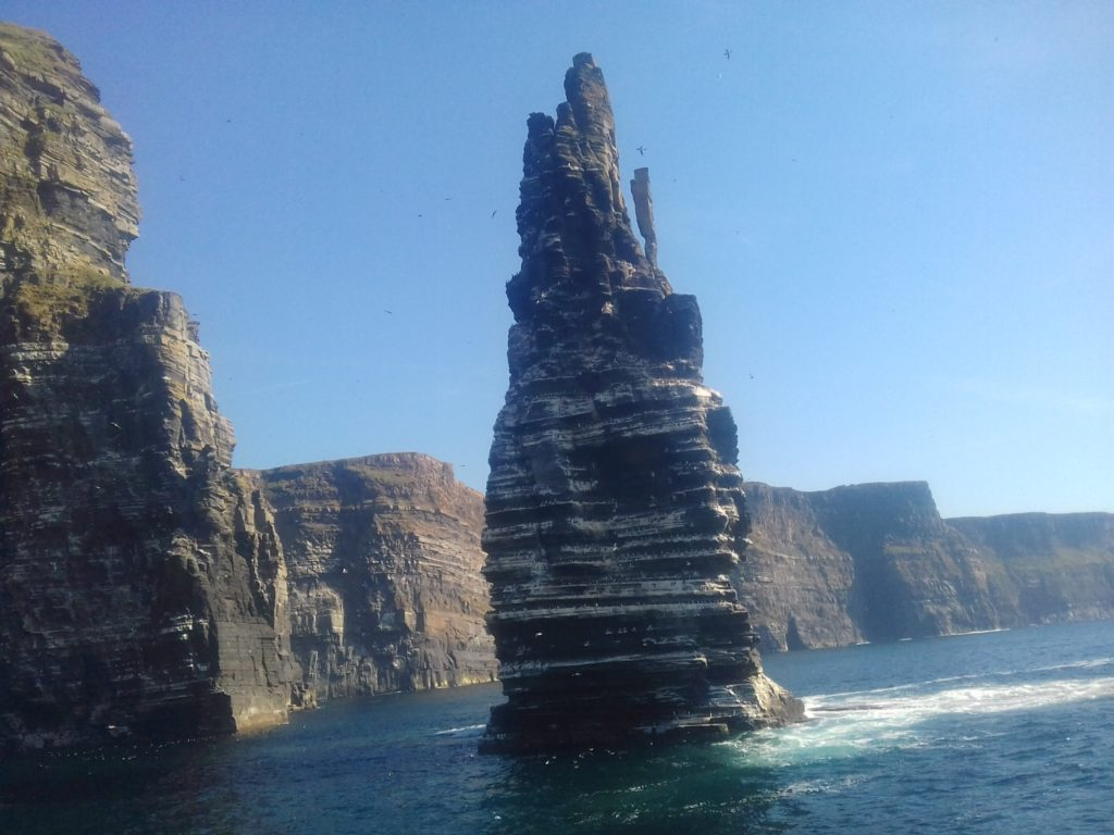 The spectacular view of the Ciffs of Moher from the ocean below them